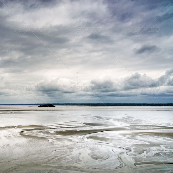 Low tide in Mont Saint Michel Bay. Normandy, France. ...  Normandie, abbey, abstract, aerial, atlantic, bay, beach, beauty, brittany, brown, cloud, coast, coastal, coastline, destination, europe, european, flood, france, french, horizon, landscape, low, michel, monastery, mont, mont saint michel, natural, nature, normandy, ocean, outdoor, pattern, pool, river, saint, sand, sandy, sea, shore, sky, surface, texture, tidal, tide, tourism, travel, vast, view, water