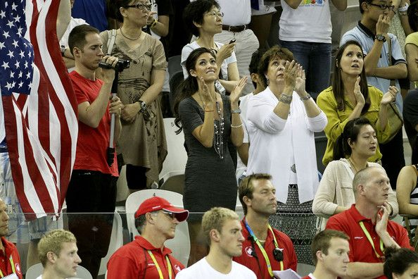 Michael Phelps and Nicole Johnson Photos Photos - Michael Phelps's girlfriend Nicole Johnson (ex-Miss California), his mother Debby and his sister Hilary cheer him on at the 14th FINA Swimming World Championships in Shanghai. - Athletes Compete at the 14th FINA Swimming World Championships