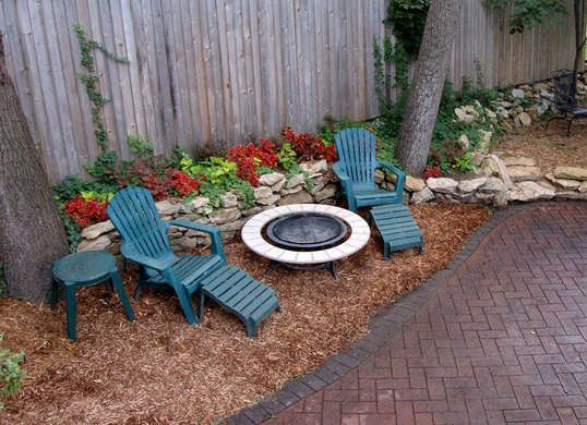 If you're tired of mowing, try covering grass with landscaping fabric, then mulch to prevent weeds and grass from coming through. Easy no maintenance yard.