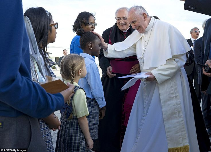 Blessings: Pope Francis reaches out to 5th grader Omodele Ojo of Brooklyn as he is greeted on his arrival at John F. Kennedy Airport