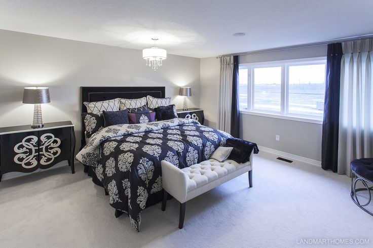 Unique patterns tie together in this Penny Lane Estates bedroom. By Landmart Homes. Stoney Creek, Ontario. #hamont #bedroomideas