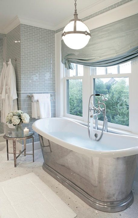 Now this is a tub! I would love to soak in this! Also love love the the smoke color of the glass subway tile! Love everything about this bathroom! https://www.subwaytileoutlet.com/products/Smoke-Glass-Subway-Tile.html#.VVpUNflViko