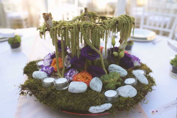 """Enchanted forest"" table center with purple, green and orange, complete with moss and tea lights"