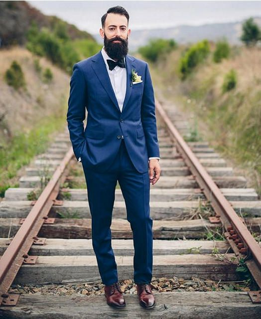 Great combo. #navy blue #suit paired with ultra #glossy #cordovan #brown shoes, #bowtie and #boutonniere. See more at http://www.wellgroomedblog.com/2016/03/well-groomed-q-navy-tuxedo-with-brown.html