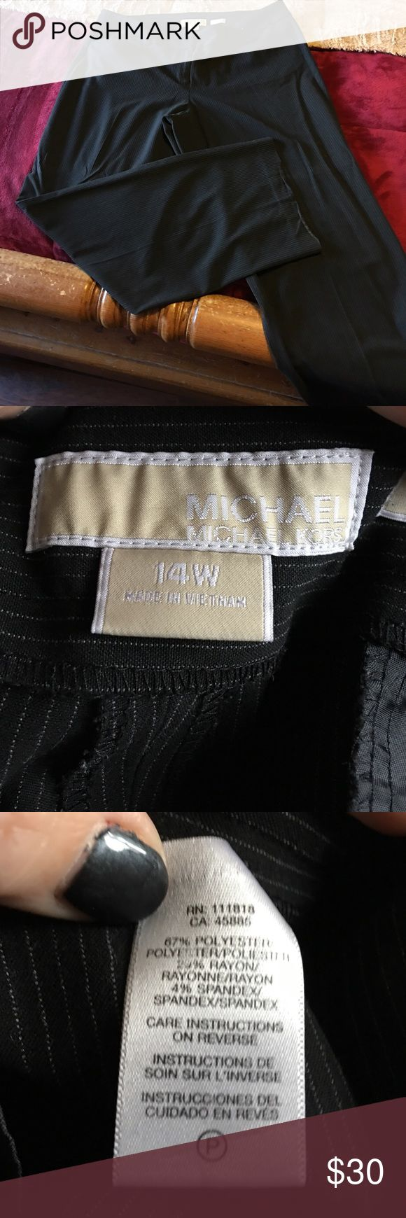 Women's Michael Kors 14W black pinstripe pants. Nice 14w Michael Kors women's trouser pants. These are black with a faint white pinstripe. Very flowing and comfy, look great on! These pants go with everything and would be a fantastic addition to anyone's wardrobe! No rips or tears but do show a little wear in the creases at the hem. Not noticeable when wearing just want to be honest. VERY SLIMMING!!! MICHAEL Michael Kors Pants Trousers