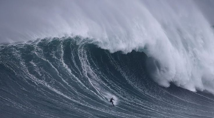 Sebastian Steudtner of Germany drops in on a large wave at Praia do Norte in Nazare, Portugal.