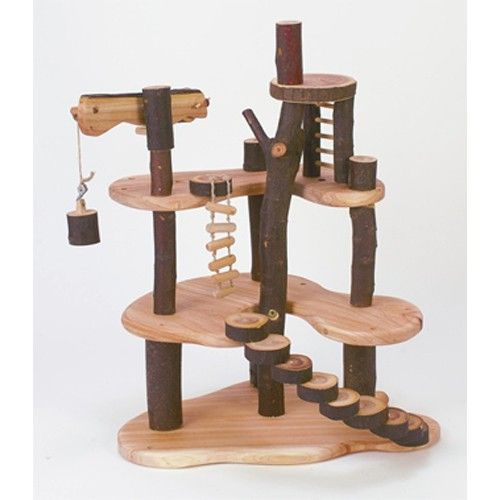Tree Cottage from Tree Blocks - This smaller version of our Build-a-Treehouse Set comes partly assembled with crane, rope ladder, spiral stairs, ladders and lookout. $99.95 for cottage; $57.95 for furniture set.