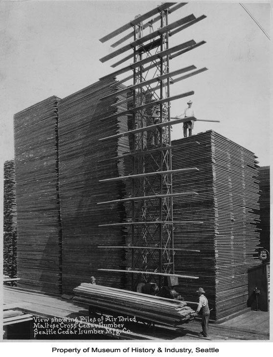 Men stacking lumber at Seattle Cedar Lumber Manufacturing Company, ca.1920