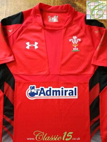 Official Under Armour Wales home pro-fit rugby shirt from the 2013/2014 season. Complete with textured grip assist on the body and sleeve.
