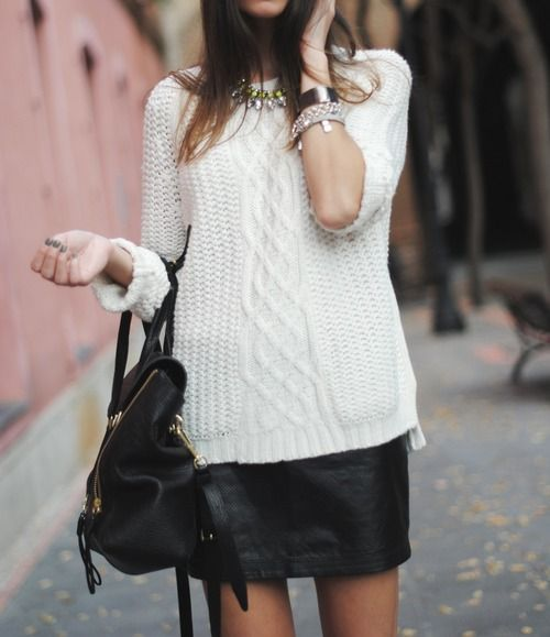 Chunky sweater and leather skirt combo for fall. Must have! Shop the look here!