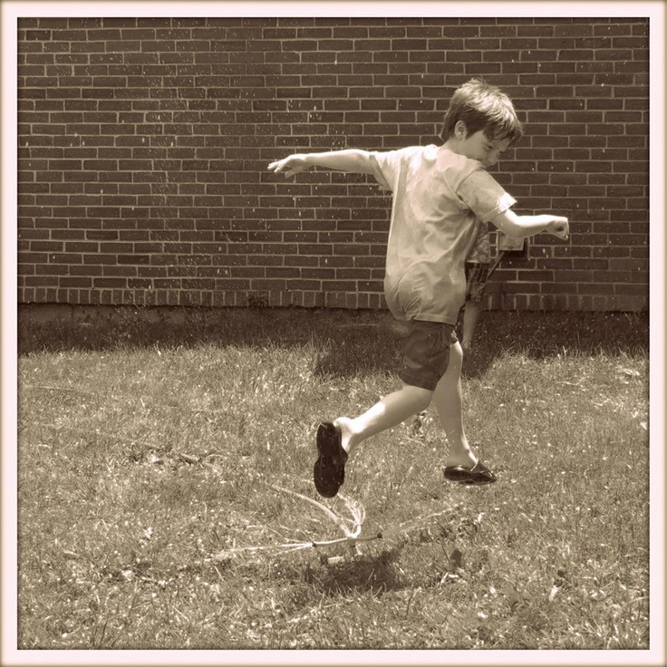 June 1st, 2013...Jumping through the sprinkler on a hot day...one of those golden moments of childhood