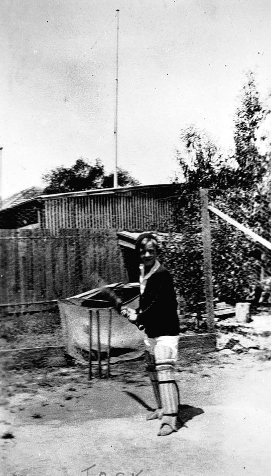 A boy playing cricket at 'Warrawee'. Ormond, Victoria Australia, circa 1930