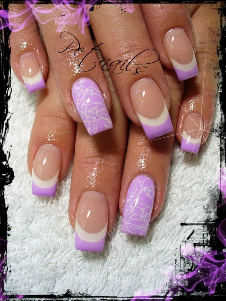 Lilac white french tipped nails with a standout flower design on the ring…