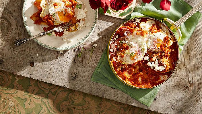 Tomato and chipotle bathed corn chips with fried eggs (chilaquiles rojas) recipe : SBS Food