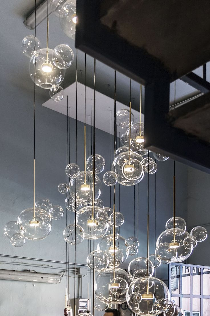 """Bolle is inspired by the lightness of soap bubbles as a metaphor for the immateriality of light. Using the """"a lume"""" technique from the Veneto region in Italy, Bolle houses a suspended brass bulb within..."""