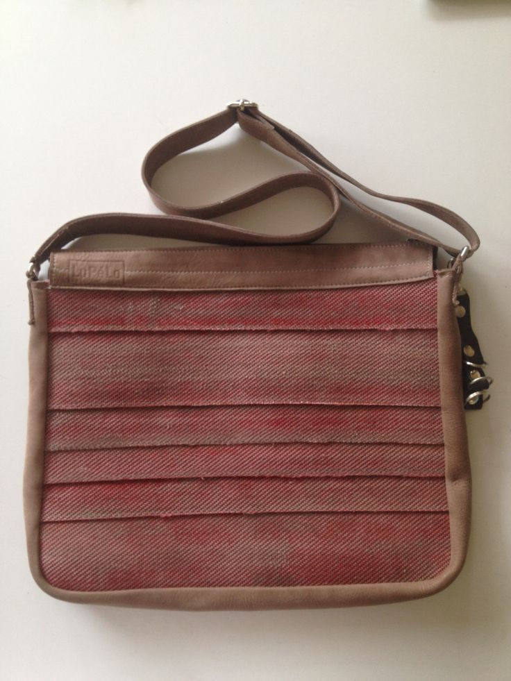 Schoolbag, made of used firehose and leather