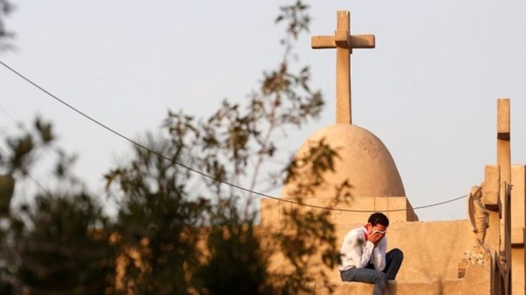 December 12, 2016: A man cries during the funeral of victims killed in the bombing of Cairo's Coptic cathedral, at the Mokattam Cemetery in Cairo, Egypt.