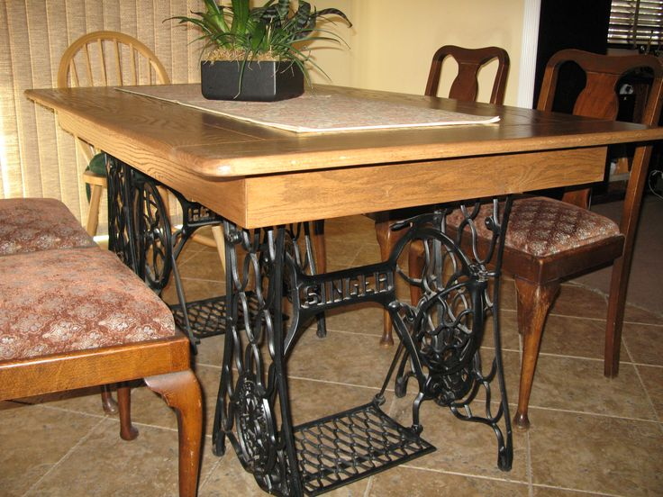 my husband made me this dining room table out of 2 old singer sewing machine bases. beautiful ideas. Home Design Ideas