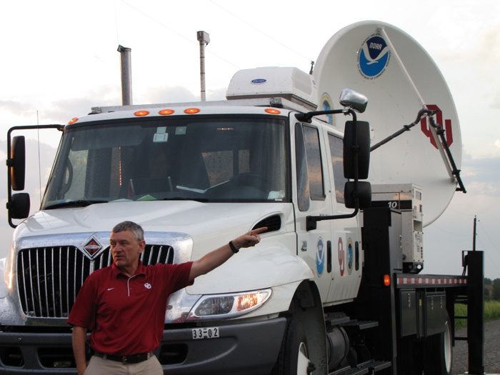 """NSSL retired scientist Don Burgess pioneered the concept of """"nowcasting"""" by using radar to direct an NSSL research team during a tornado intercept and lead the discovery of the """"tornado vortex signature"""" seen in radar displays. Burgess leads the NO-XP mobile radar team.       Image ID: nssl0272, NOAA's National Severe Storms Laboratory (NSSL) Collection   Location: Nebraska, Omaha  Photo Date: 2009 May 31  Photographer: Susan Cobb, NOAA/OAR/NSSL  Credit: VORTEX II"""