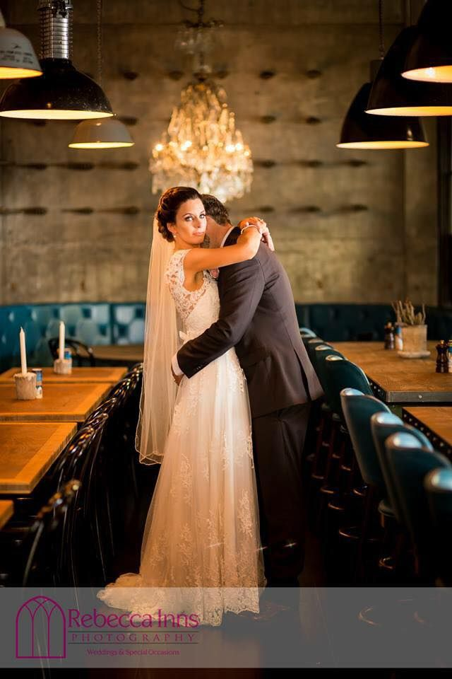 A restaurant has never looked so good! Liah Roebuck Bridal real bride 2015 shot by Rebecca Inns Photography. Full lace vintage wedding dress www.facebook.com/LiahRoebuckBridal