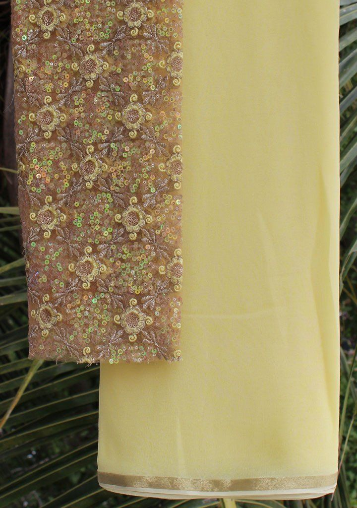 A simple plain yellow Saree in georgette paired with a gorgeous embroidered blouse piece.