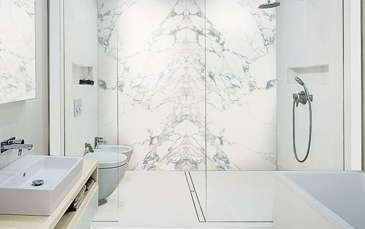 PLANE Arabescato porcelain slabs look like the real deal -- only 6mm thick and come as large as 120x60 -- www.hudsontilesupply.com