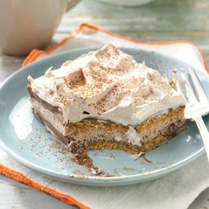 Chocolate Eclair Delight Recipe -It's amazing how the layers soften overnight into a cake-like texture. Just before serving this dessert, I like to dust the top with cocoa. —Agnes Ward, Stratford, Ontario
