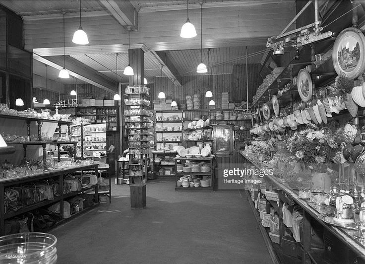 Co-op store showing a sales receipt transfer system, Barnsley, South Yorkshire, 1955. The Fancy good department at the Barnsley Co-op in 1955 prior to its refurbishment. A variety of porcelain and kitchenware can be seen on display but of more interest is the corded system of transferring sales receipts, which can be seen above the shop floor. The system (in this case a Dart Exchange) would transfer the sales receipt to a central point to be recorded and then back again to the customer…