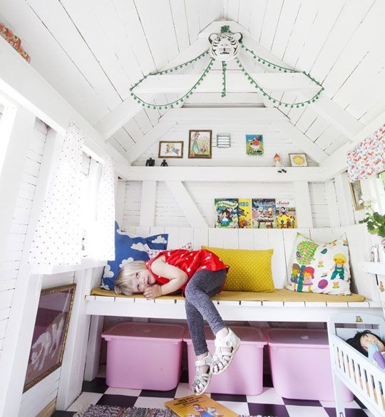 Lovely Scandinavian design for a child's room. Bright white walls, and lots of pops of color throughout.