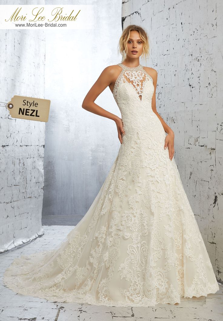 Style NEZL Kailani Wedding Dress Frosted Alecon Lace Appliqués Accent This Net A-Line Gown Wedding Gown Trimmed with Moonstone and Crystal Beading. Available in Three Lengths: 55″, 58″, 61″. Colors Available: White, Ivory, Ivory/Champagne