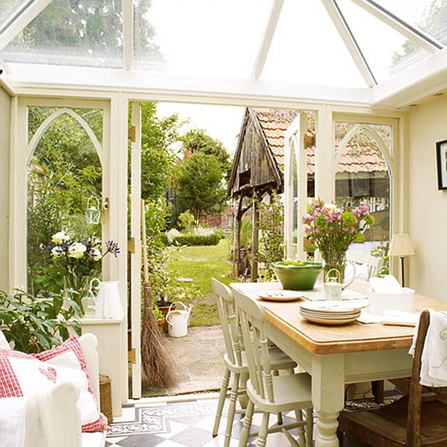 This sunroom is my favorite room in the house. Love the windows, the floor, etc.