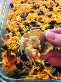 Dr. Oz's 7 Layer Fat-Fighting Dip- 4 cups shredded lettuce, 3 medium ripe avocados mashed and mixed with 2 tbsp lemon juice, 1 1/2 cup Greek yogurt mixed with 1 package low-sodium taco seasoning mix, 1 can black beans, 3 medium diced tomatoes, 2 cans sliced olives, 8 oz 2% cheddar cheese