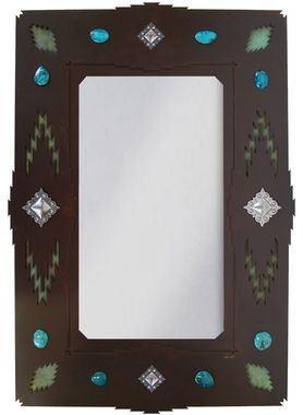 Beautiful Southwestern design makes this unique wrought iron mirror a showpiece! Handcrafted with a desert diamond and jewel motif including polished rock accents..