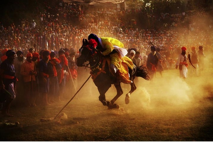 Hola Mahalla is a Sikh festival that takes place in March. Estabished by Guru Gobind Singh, follows the Hindu festival of Holi by one day; Hola is the masculine form of the feminine sounding Holi.