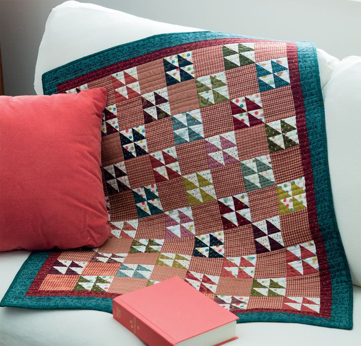 Mix plaids and polka dots in this little charm quilt to add movement and fun! From the new book Sew Charming.