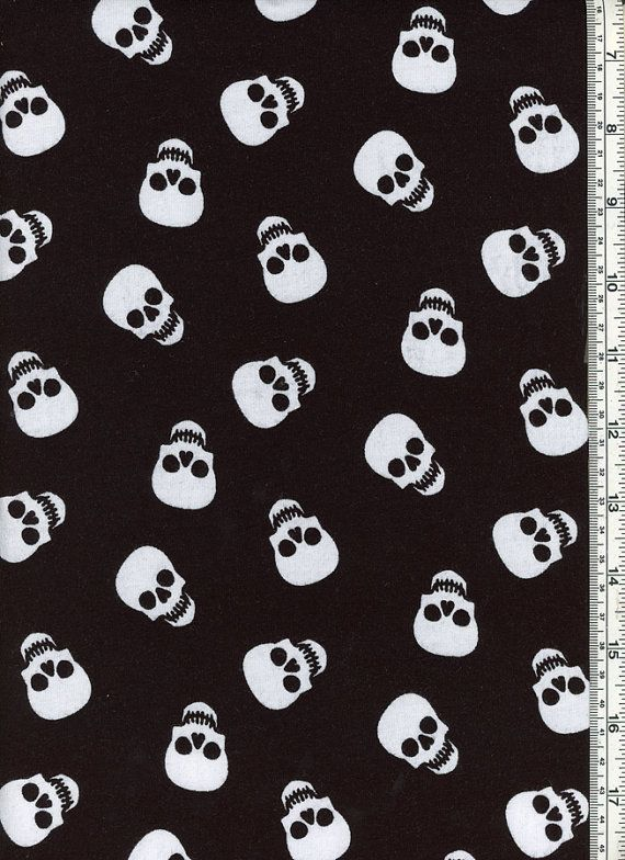White Skulls on a Black Cotton Lycra Fabric by NouvelleFabrics