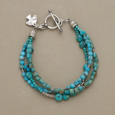 """From rounded to angular and blue to green, different shapes and shades of turquoise team up with Thai silver beads. The three-strand bracelet closes with a sterling toggle. Exclusive. Handmade. Approx. 7-1/4""""L."""