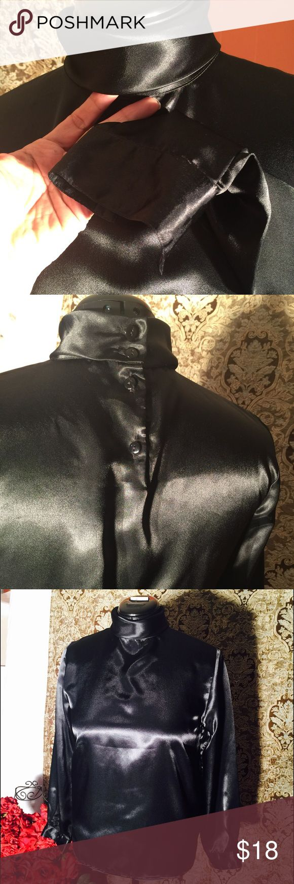 Rebecca Malone top Rebecca Malone satin silk blouse size medium/large high neck button in the back long cuffed sleeves. very beautiful silky soft black will look perfect with pencil skirt or mini even jeans or slacks very versatil (Shop and feel good about it 😁. Part of the money u spend goes to Purple Heart Foundation 💜)e Rebecca Malone Tops Blouses