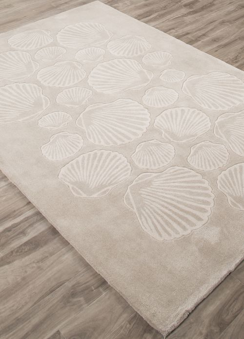 A patterned design reminscent of a beach full of seashells, this new tan coastal rug offers an updated, luxurious beach house feel.