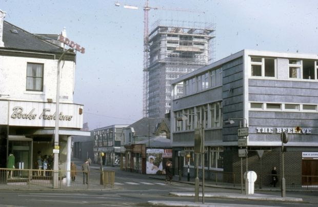 """It's all change here as the new """"space age"""" town is built behind Books Fashions and the Beehive pub in around 1968."""