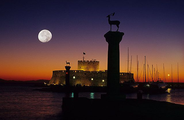 This is a night view of where the Colossus of Rhodes it is said it used to be standing. http://en.wikipedia.org/wiki/Colossus_of_Rhodes