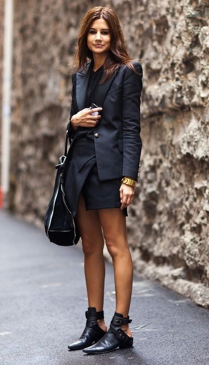 All black is always a winner. Great blazer and open back boots. Also digging the asymmetric hem on the skirt.