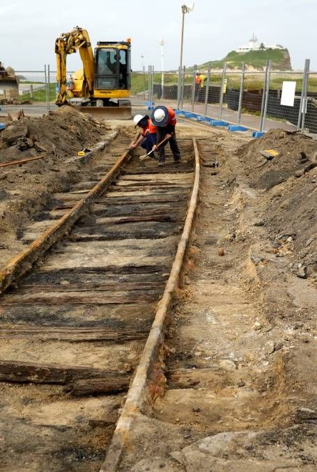 Old train tracks uncovered at Nobbys Beach, Newcastle. Pic: JONATHAN CARROLL