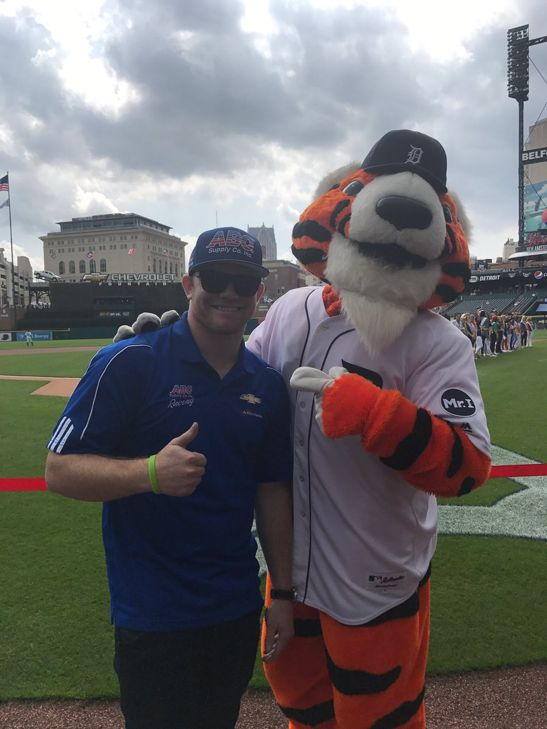 Getting ready to throw the first pitch out  at the @tigers game today, @ConorDaly22 is getting some tips from @PAWSDetroit #INDYCAR