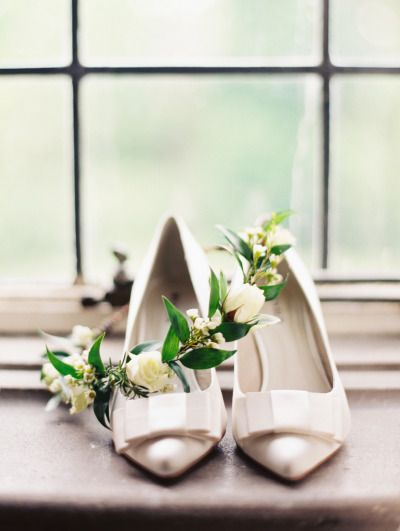 Ivory shoes and a delicate floral crown: http://www.stylemepretty.com/2015/01/28/organic-and-elegant-laurel-hall-wedding/ | Photography: Megan W - http://www.megan-w.com/