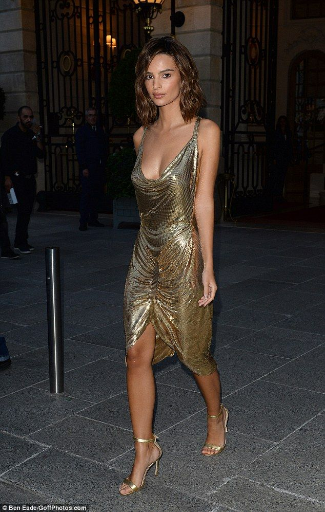 Gold rush! Emily Ratajkowski goes braless in a slinky shimmering cocktail dress as she continues to display her newly-chopped locks during Paris Fashion Week