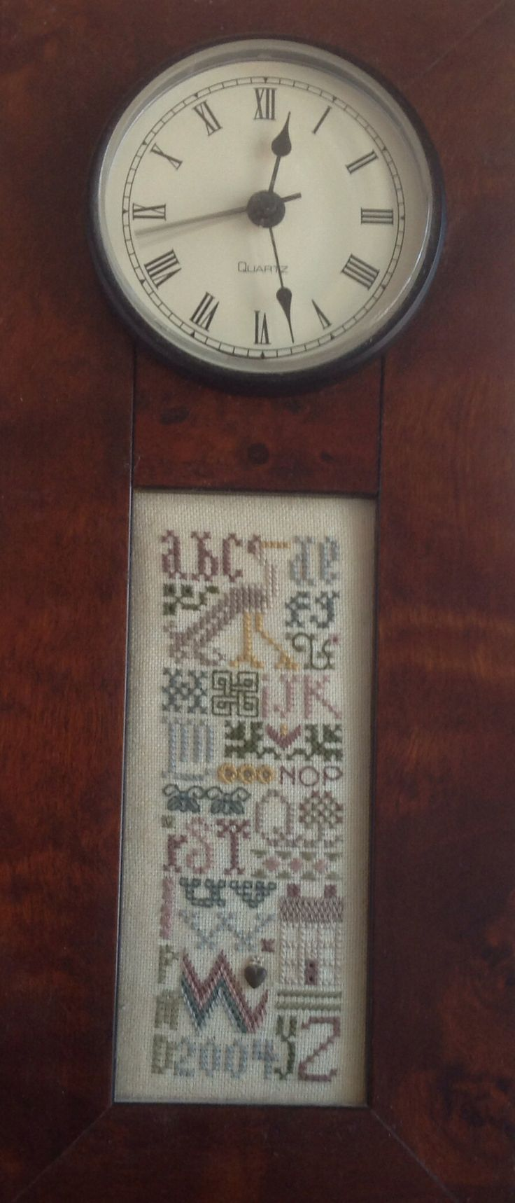 Clock, drawn thread design, stitched by Penelope Darby