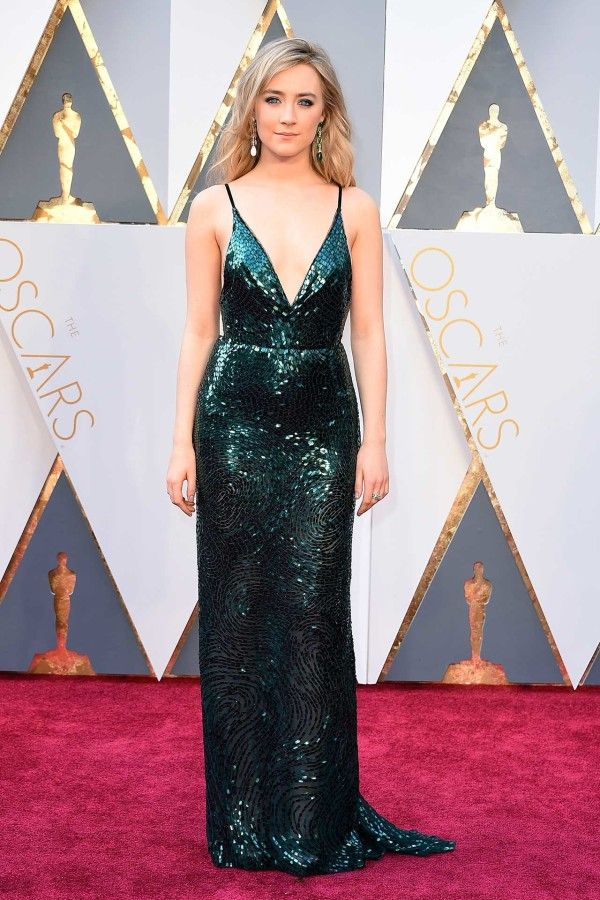 Saoirse Ronan in Calvin Klein - TheBrooklynstar also wears matching earrings with mismatched stones.