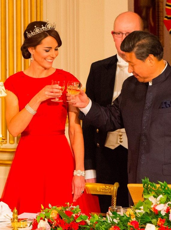 Catherine and Xi Jinping toast at her first state banquet. #duchessofcambridge #reddress #royalfashion