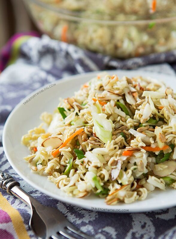 1 bag of cole slaw or broccoli slaw Bunch of green onions, chopped Crunchies: 1 package of chicken flavored ramen 2 tbsp toasted sesame seeds 1/2 cup toasted slivered almonds 2 tbsp sunflower seeds Dressing: 1/2 veg oil 1/4 cup rice wine vinegar 2 tbsp sugar Salt Pepper Seasoning package Mix all ingredients. Add crunchies about an hour before serving.